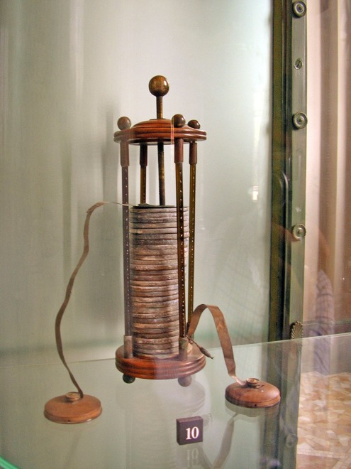 "Volta's early ""Voltaic pile"" battery consisted of copper and zinc rods separated by pieces of cloth soaked in brine. When several of these units were piled atop one another and connected end-to-end by a wire, an electrical current flowed."