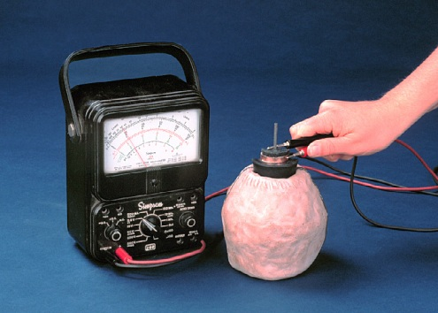 Here is a reproduction of a Baghdad battery connected to a multimeter.