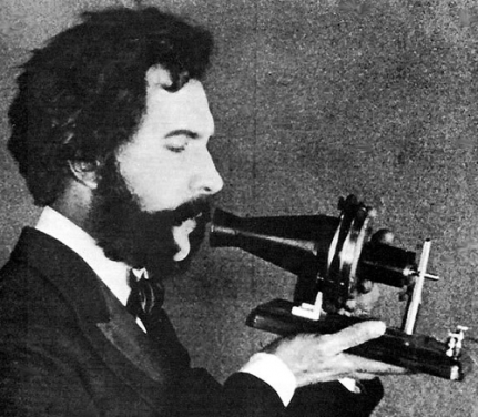 Alexander Graham Bell with an early model of the telephone, an invention that owes much to Faber's advances