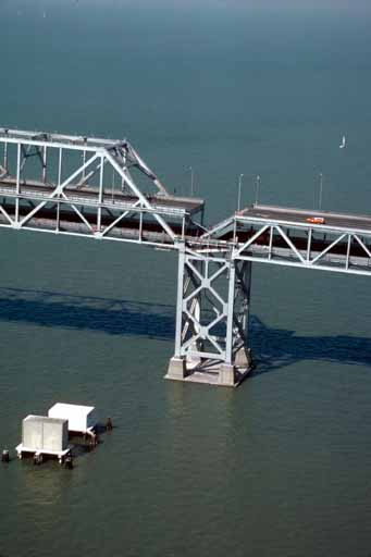 "Some claim that the Loma Prieta earthquake that ravaged the San Francisco Bay Area in 1989 was preceded by ""earthquake weather"". This photograph depicts the part of the Bay Bridge that collapsed during the temblor, which was broadcast on live TV due to the fact that the San Francisco Giants were playing in the World Series at the time."